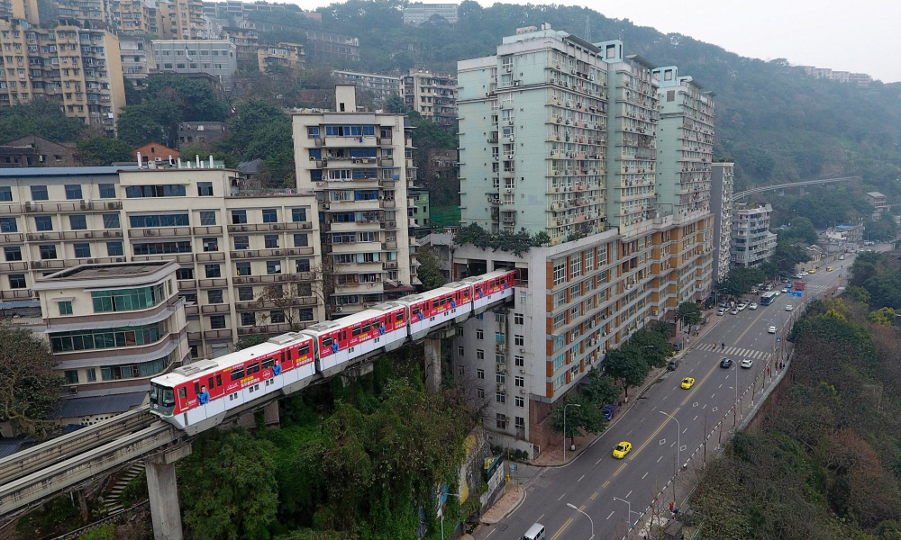 Train Goes through 19-Storey Block of Flat in China