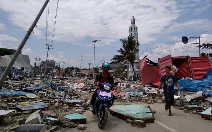 Palu after tsunami and earthquake ( source : Radio NZ | AFP)