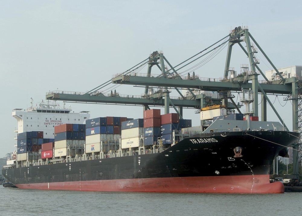 containers are loaded on a ship at the Saigon port in Ho Chi Minh city, Vietnam.