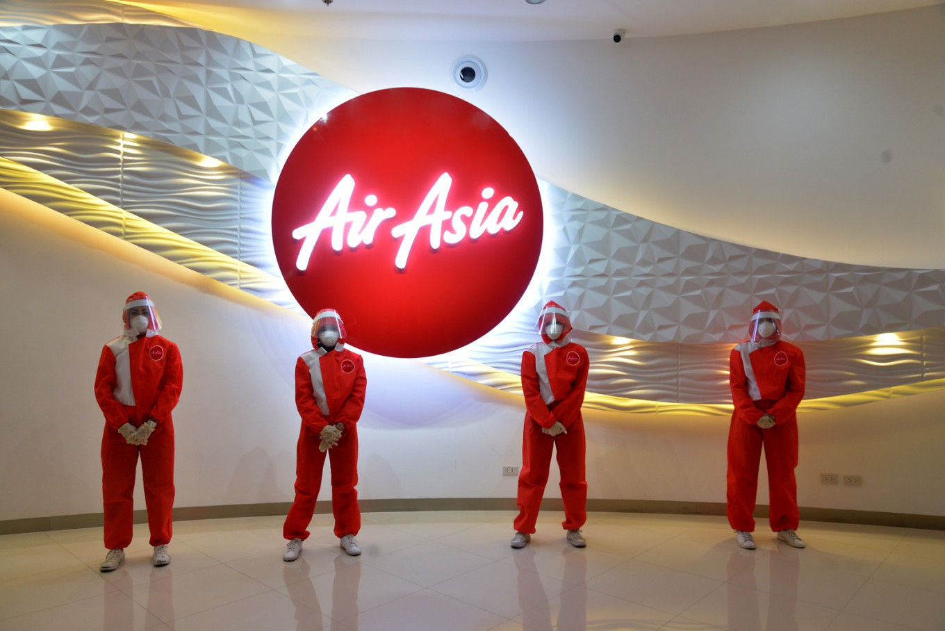 Amid the COVID-19 pandemic, low-cost carrier AirAsia introduced on Friday new personal protective equipment (PPE) for its cabin crews. Image: AirAsia Philippines/File