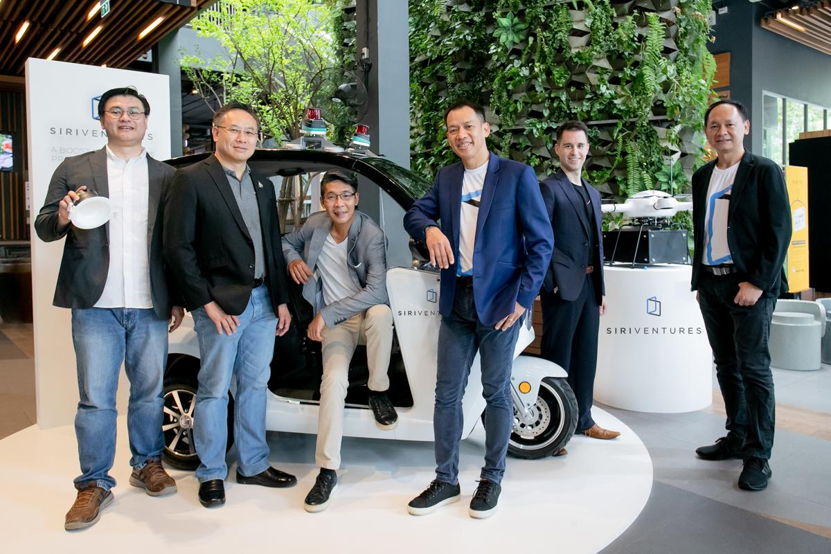 Autonomous cars and air-taxi drones are a trend, says Mr Jirapat (third right). Image: Bangkok Post