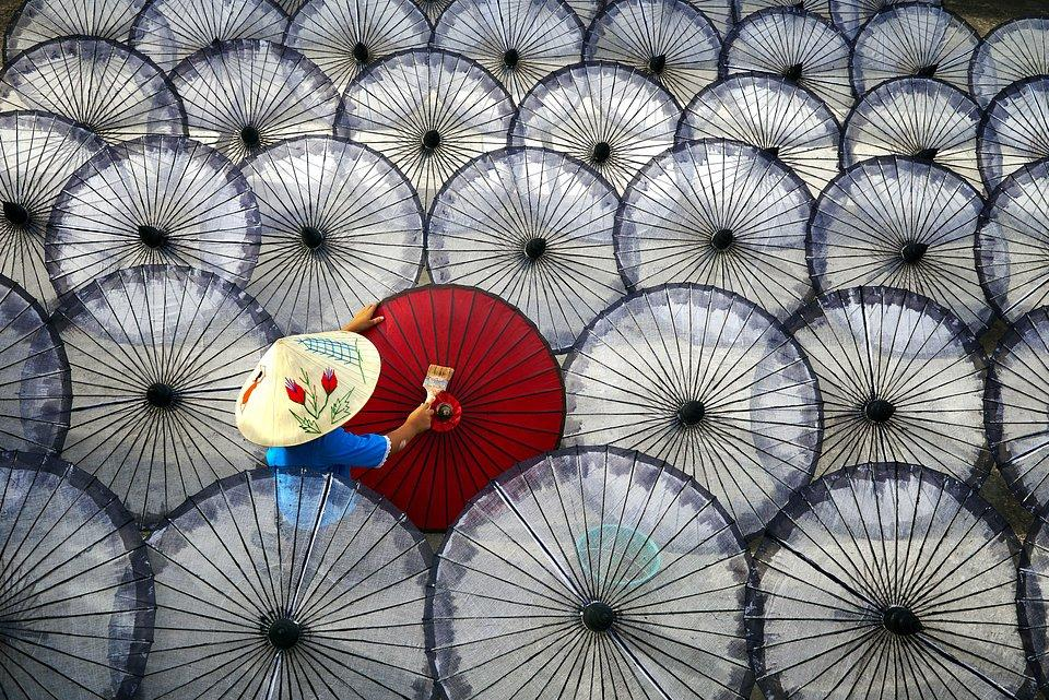 'Girl', a young woman painting umbrellas in Mandalay, Myanmar. Finalist. PHOTO: @CHANTHAR, MYANMAR - AGORA