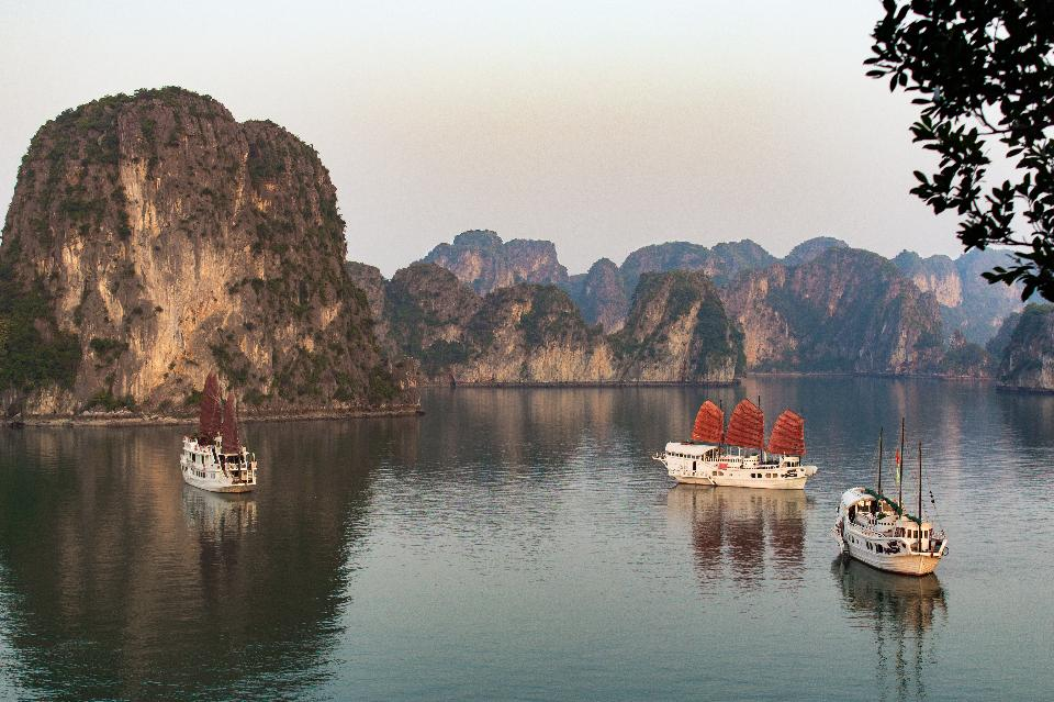 Boats sit in the harbor in Halong Bay, Vietnam. image: Shutterstock