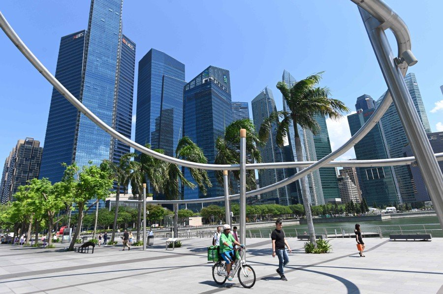 Singapore Prime Minister Lee Hsien Loong announced that the retirement age will be increased by three years from the current retirement age of 62. Image: AFP/File pic
