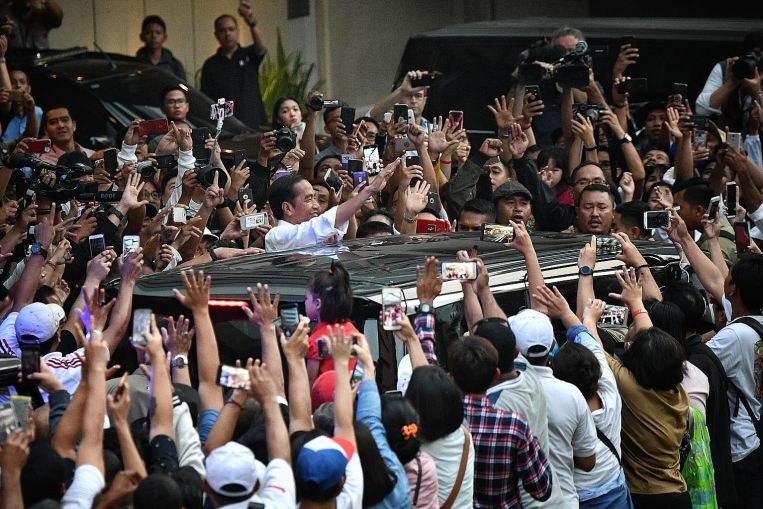 A crowd of supporters cheering Mr Joko Widodo in Jakarta after the presidential election in April. Image: ST PHOTO/ARIFFIN JAMAR