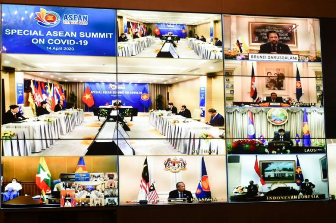 A Thai government handout photo shows multiple screens of ASEAN leaders joining the special coronavirus summit hosted by Vietnam. Image: ROYAL THAI GOVERNMENT/AFP Handout