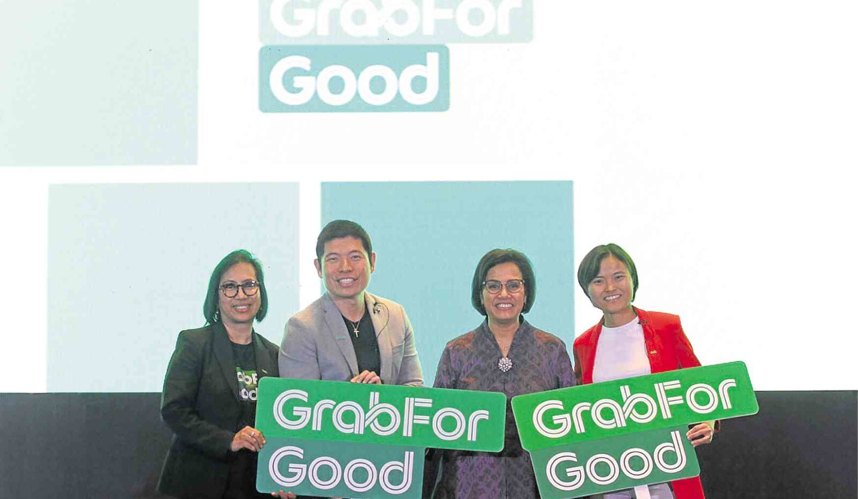 (From left) Neneng Goenadi, managing director, Grab Indonesia; Anthony Tan, CEO and co-founder, Grab; Sri Mulyani, Minister of Finance of the Republic of Indonesia; Hooi Ling Tan, co-founder, Grab.  Image: Inquirer