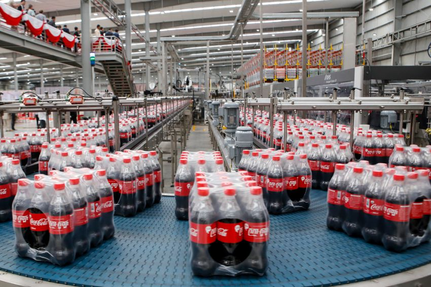 Hundreds of bottles of Coca-Cola are ready to be distributed from the company's new factory in Phnom Penh's Special Economic Zone. image: Phnom Penh Post