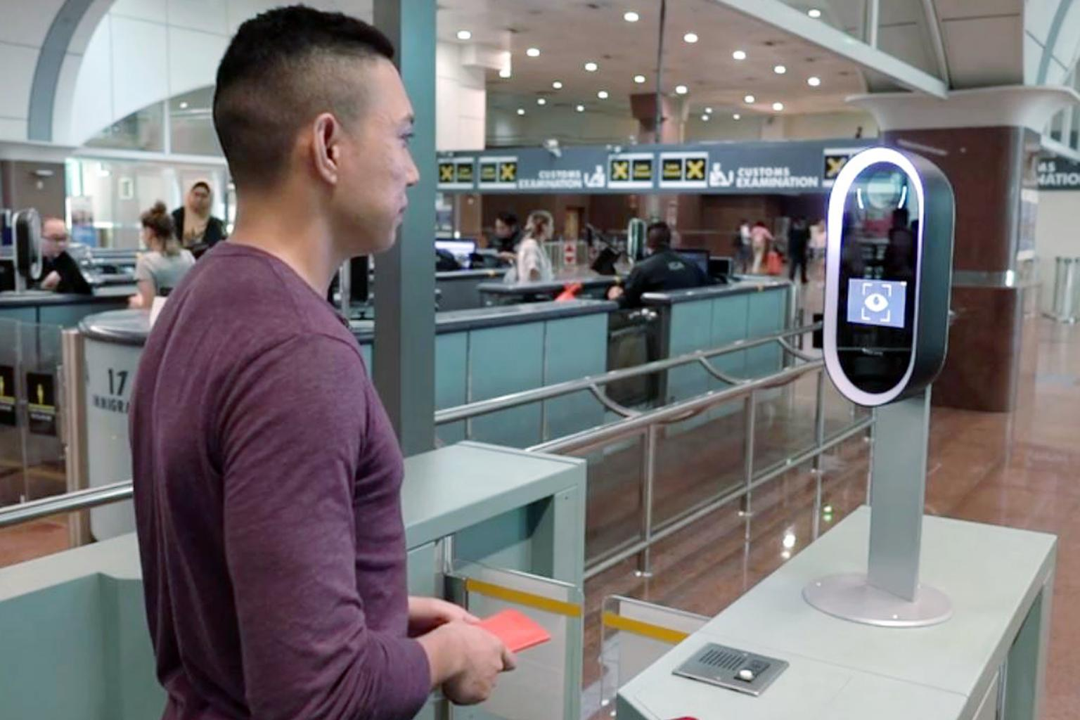 A trial in the immigration hall at Tuas Checkpoint that uses iris and facial images to clear immigration. Image: ST FILE