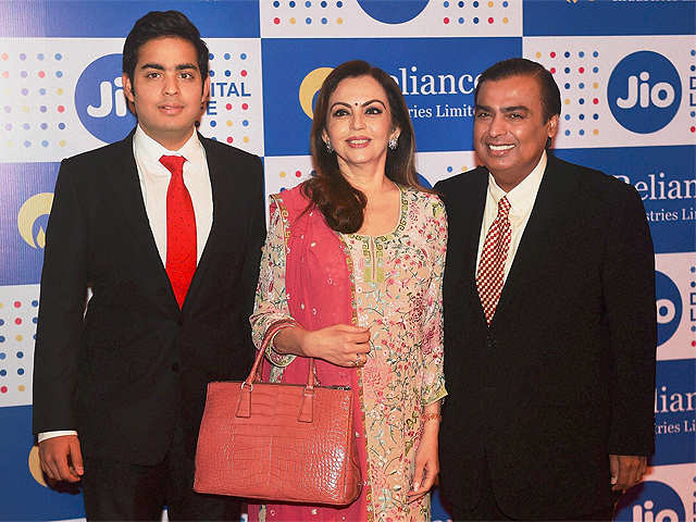 Mukesh Ambani, Chairman, Reliance Industries Ltd. with his wife Nita Ambani and son Akash Ambani arrives for the company's annual general meeting in Mumbai. Image: India Times