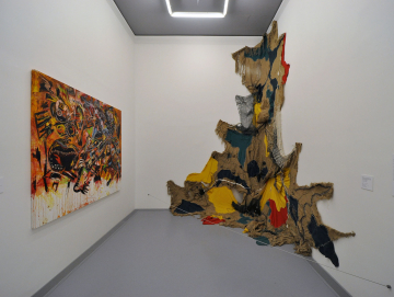 A view of at Five Bhobh at Zeitz MOCCA with a work by Janet Siringwani-Nyabeze on the left and one by Shalom Kufakwatenzi (in collaboration with Troy Makaza) on the right. Image: Hrag Vartanian/Hyperallergic