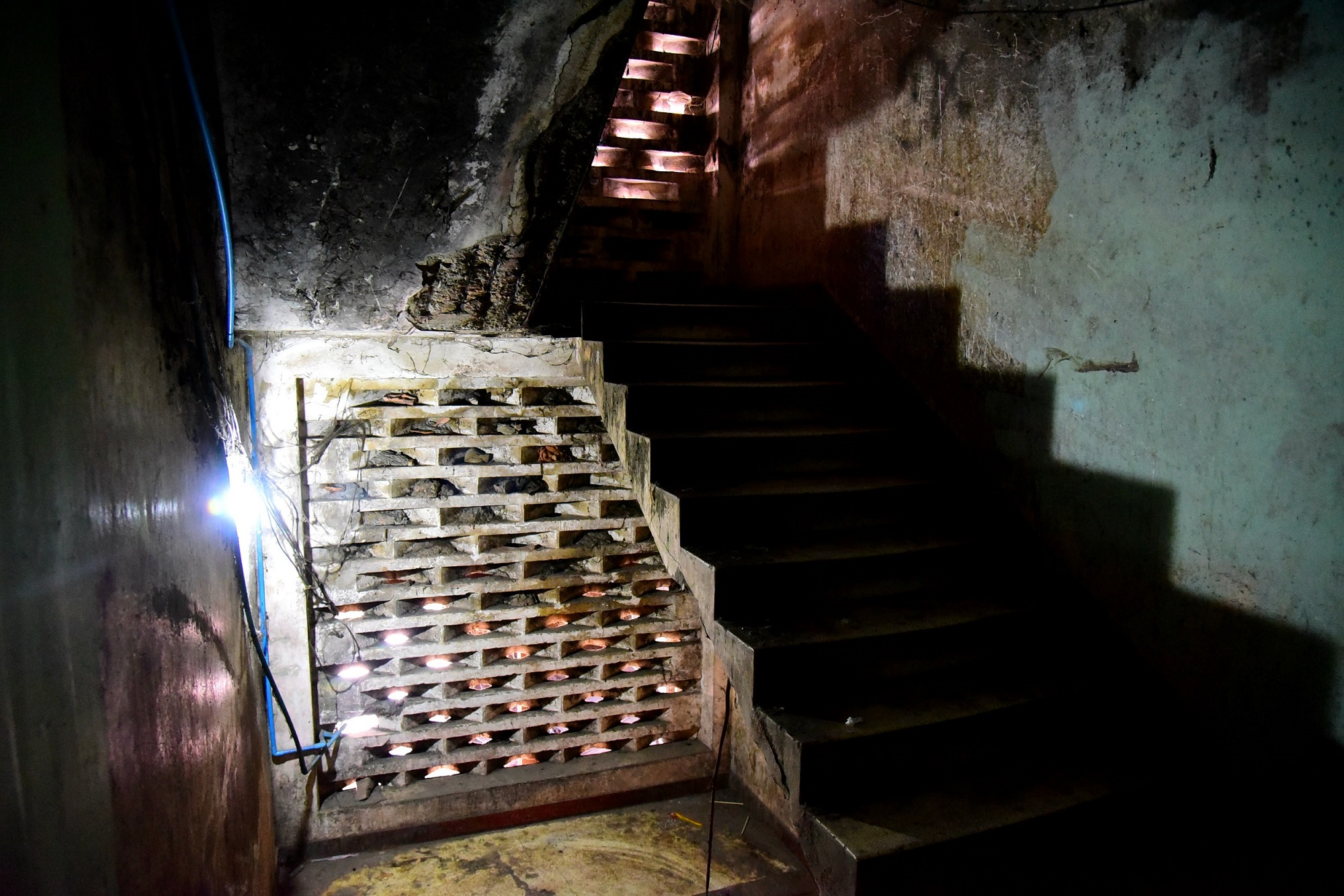 A decrepit staircase inside the White Building.